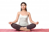 Woman meditating in lotus position — Stock Photo
