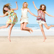Group of young woman jumping on beach — Stock Photo #63949179