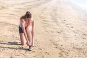 Woman running on the beach — Stock Photo