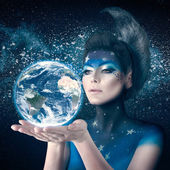 Moon woman holding planet earth — Stock Photo