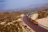 Large train passing through the curve — Stock Photo