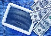 Dollars and blackboard — Stock Photo