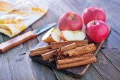 Apples and cinnamon — Stock Photo