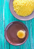 Raw egg with panco — Stock Photo