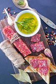 Salami and basil — Stock Photo