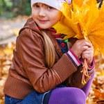 Little girl in autumn park — Stock Photo #56570999