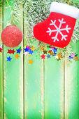 Christmas sock, ball and confetti — Stock Photo