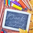 Chalkboard, school supplies and autumn leaves — Stock Photo #57091107