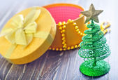 Toy christmass tree and box — Stock Photo