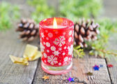Candle and branch of christmas tree — Stok fotoğraf