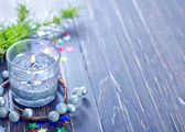 Candle and christmas decorations — Stok fotoğraf
