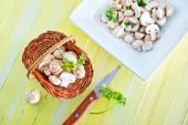 Raw mushrooms in basket — Stockfoto