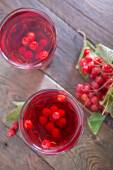 Viburnum drink in the glass — Photo