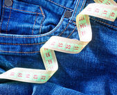 Jeans and green measuring tape — Foto Stock
