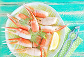 Boiled crab claws with lemon — Stock Photo