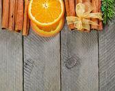 Sliced orange and cinnamon sticks — Stock Photo