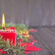 Red candle and christmas decorations — Stock Photo #59298361