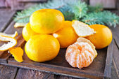 Tangerines and christmas decoration — Stock Photo