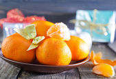 Tangerines and christmas decorations — Stock Photo