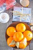 Tangerines and christmas decorations — Zdjęcie stockowe