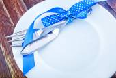 Fork and knife on white plate — Stock Photo