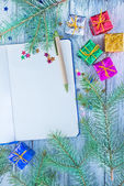 Notepad and christmas decoration — Stock Photo