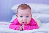 Little baby on bed — Stock Photo