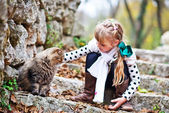 Cute little girl with cat — Stock Photo