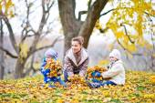 Mother and doughters in autumn park — Stock Photo