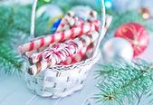 Christmas candies in wooden basket — Foto de Stock