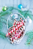 Christmas candies in wooden basket — Stock Photo