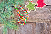 Branch of christmas tree and candy — Stock Photo