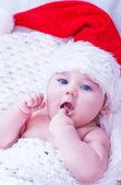 Little baby in santa hat — Stock Photo