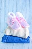 Baby clothes on a table — Stock Photo