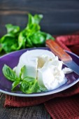Fresh ricotta with basil — Stock Photo