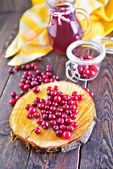 Cranberry on the wooden board — Stock Photo