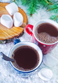 Cocoa drink in red cup — Stock Photo