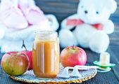 Baby food in bank — Stock Photo