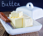 Butter on white plate — Stockfoto