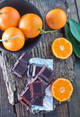 Chocolate and tangerines — Stock Photo