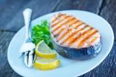 Grilled salmon steak with lemon — Stock Photo