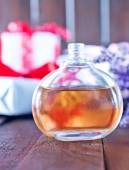 Perfume in bottle on table — Stock Photo