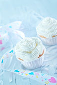 Sweet maffins with creame — Stock Photo