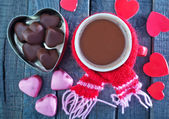 Candy and cocoa in cup — Stock Photo