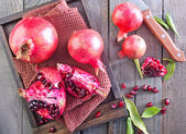 Pomegranate on napkin — Stock Photo