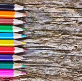 Color pencils on the wooden background — Stockfoto