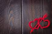 Red hears on the wooden table — Stock Photo