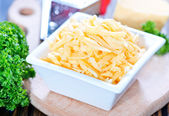 Grated cheese in bowl — Stock Photo