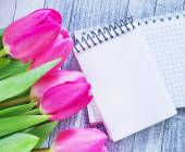 Flowers on the wooden table — Stock Photo