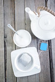 Cup for tea and tea in bag — Stock Photo